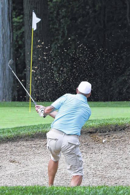 Greg Bunn finds himself in a sand trap during the First Flight at the Shawnee Country Club for the Lima City Golf Championship semi-final on Saturday evening.