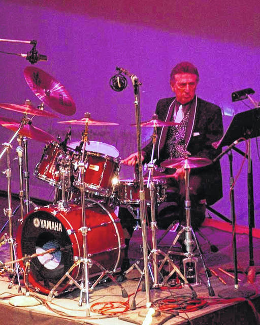FILE- In this Oct. 16, 2004 file photo, longtime Elvis Presley drummer D.J. Fontana performs at the 50th anniversary celebration concert of Elvis Presley's first performance at the Louisiana Hayride in Sherveport, La. Fontana, the drummer who helped launch rock 'n' roll as Elvis Presley's sideman, has died at 87, his wife said Thursday, June 14, 2018. Karen Fontana told The Associated Press that her husband died Wednesday, June 13 in his sleep in Nashville.