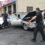 Car strikes Elida Road business