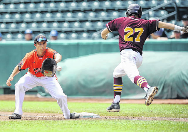 Coldwater's Austin Riethman receives the throw in time to force out Canfield South Range's Brandon Youngs during a Saturday Division III state championship game at Huntington Park in Columbus.  Richard Parrish | The Lima News