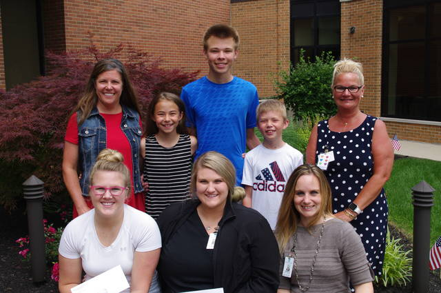 Top row, Michele Miller (Sister of Cindy Bruns), Brianna Miller, Brent Miller, Xavier Miller (niece and nephews of Cindy Bruns), and Lana Hinders, Foundation Scholarship Committee Chair and Emergency Department Director. Front Row: Elyssa Sheriff, Riley Grant and Karen Bruns.