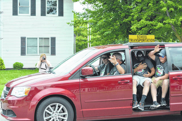Bryan Reynolds | The Lima News The Fort Jennings Envirothon team was escorted into Fort Jennings by the fire department Tuesday after winning the state championship. A crowd was waiting at The Fort on Water Street to congratulate the team.