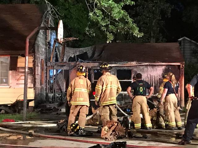 Firefighters respond to a housefire Saturday on Hazel Avenue in Lima.