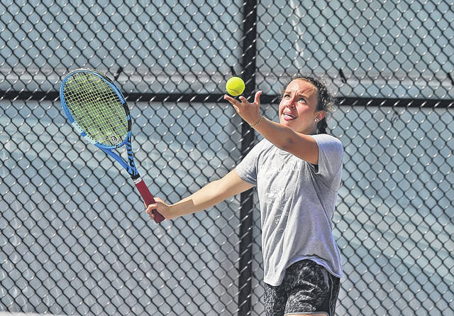 Katie Clark serves during the Lima Area Tennis Association's doubles tournament Saturday at UNOH.