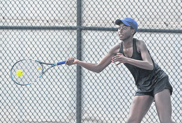 Kunmi Ojo hits a return during the Lima Area Tennis Association's doubles tournament Saturday at UNOH.