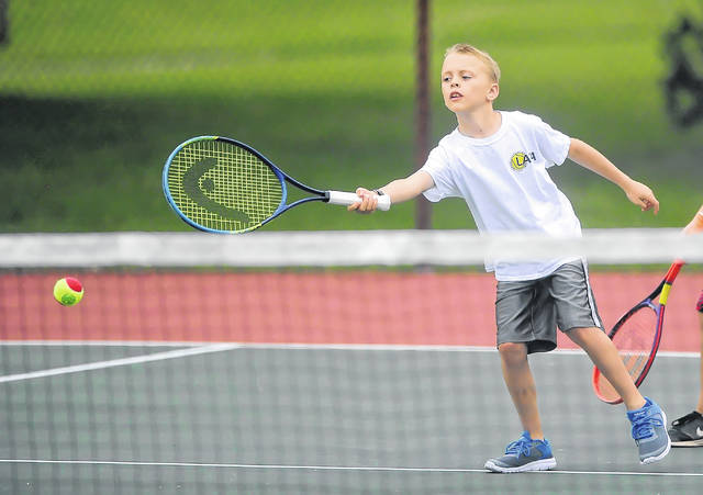 Ethan Ferryman, 10, makes a return during Monday's Lima Area Tennis Association and Lima Parks and Recreation Department free tennis lessons camp at Collett Street Tennis Courts.
