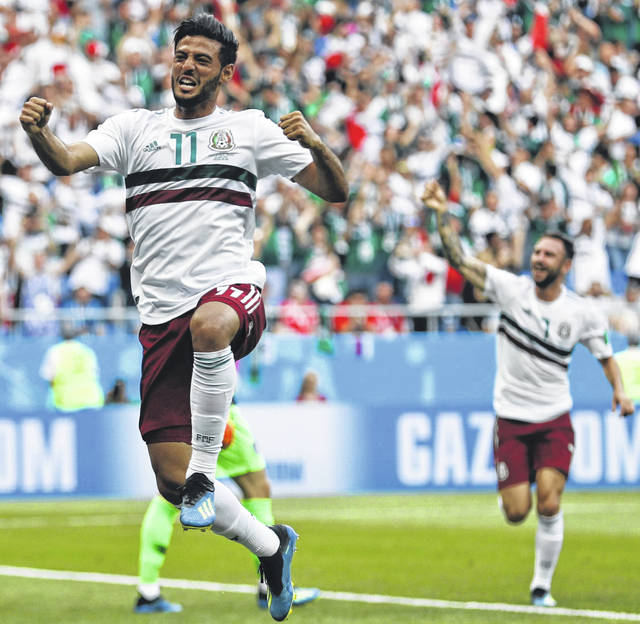 Mexico's Carlos Vela celebrates after scoring the opening goal during the group F match between Mexico and South Korea at the 2018 soccer World Cup in the Rostov Arena in Rostov-on-Don, Russia Saturday.