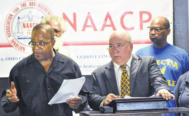NAACP president, Pastor Ron Fails, left, addresses a press conference with Ray Magnus, NAACP spokesperson at Grace Church Ministries in Lima on Wendnesday. The conference was called to discuss the positive work done by area law enforcement.