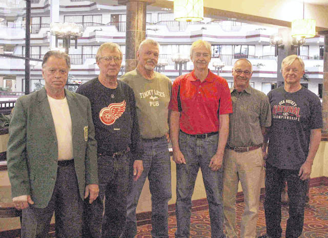 Former members of the Lima Chargers and Lima Blues hockey team, from left, Mike Chartrand, Bob McBroom, Randy Winkle Jr., Dave Harvey, Chris Allenbrock and Neal Whitney got together to plan a reunion for teammates and fans of the two hockey teams that played in Lima. The tentative date for the reunion is July 21.