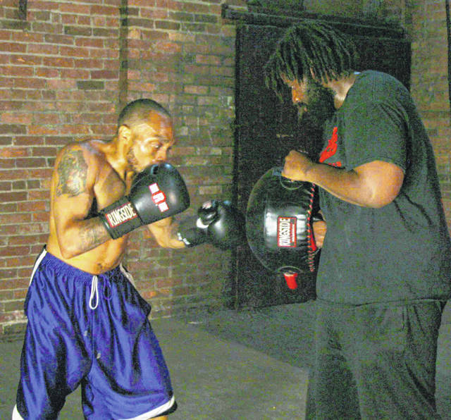 """Eddie Hines, left, works out with Marquis Valentine as the two prepare for big fights Saturday. Valentine is part of the main event and fighting for the unofficial title of """"best heavyweight in Ohio."""""""