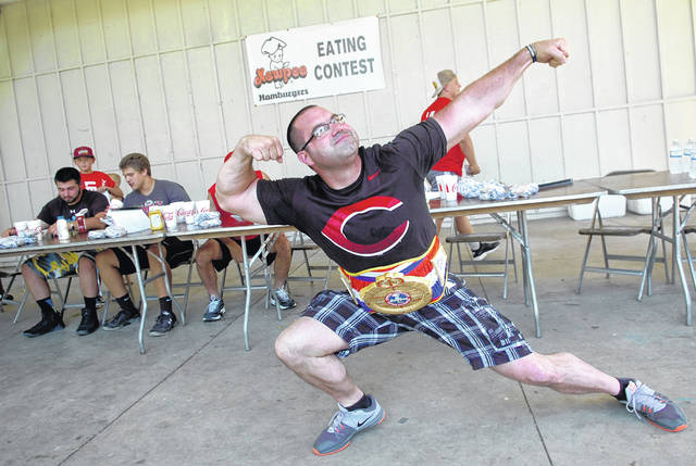 Cory Lee, of Spencerville, strikes a pose last year with his championship belt after winning the Kewpee hamburger-eating contest during Star Spangled Spectacular.