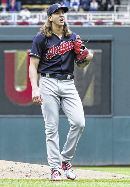 Cleveland Indians' pitcher Mike Clevinger yells to catcher Yan Gomes after giving up a solo home run to Minnesota Twins' Eddie Rosario in the first inning of a baseball game Sunday, June 3, 2018, in Minneapolis. (AP Photo/Jim Mone)
