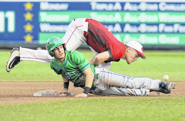 Wapakoneta's Mitch Apple is upended as Chaminade-Julienne's Cameron Benoit slides safely into second base with a steal during Saturday's Division II state championship game at Huntington Park in Columbus.