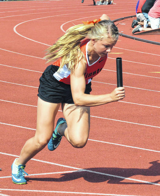 Minster's Cassie Francis starts the Division III 400 meter relay at Saturday's state track and field championships at Jesse Owens Memorial Stadium in Columbus.