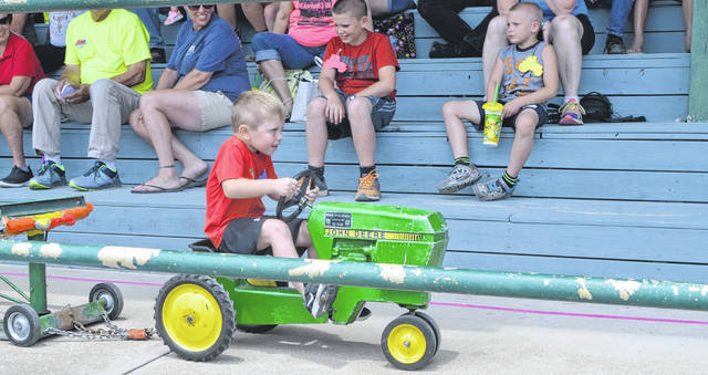 Easton Woods participates in the Kiddie Tractor Pull Tuesday at the Putnam County Fair Kids Day.