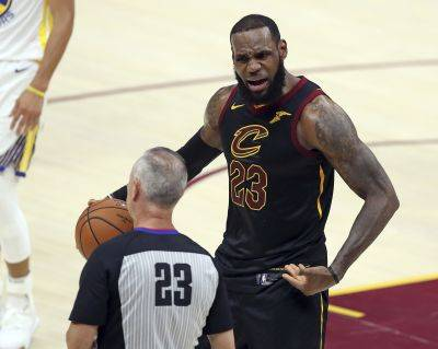 Cleveland Cavaliers' LeBron James argues a call Friday night with referee Jason Phillips during Game 4 of the NBA Finals against the Golden State in Cleveland.