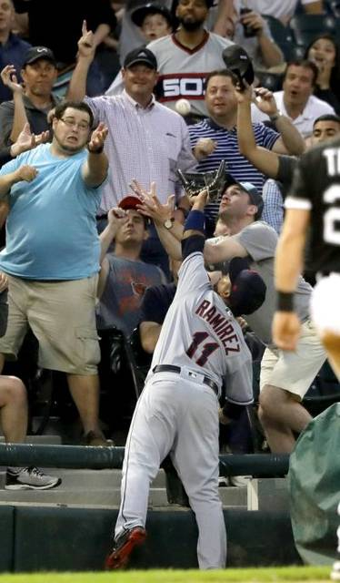 Cleveland Indians' Jose Ramirez catches a popup by Chicago White Sox's Yoan Moncada in foul territory to end the fourth inning of a baseball game Tuesday night in Chicago. (AP Photo/Charles Rex Arbogast)
