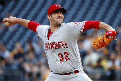 Cincinnati Reds starting pitcher Matt Harvey delivers in the first inning of Friday night's game against the Pirates in Pittsburgh. AP Photo