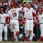 Votto breaks drought with grand slam as Reds beat Tigers 9-5