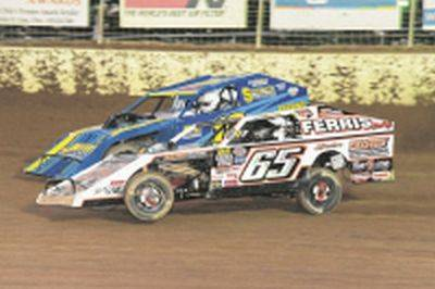 Ryan Sutter battles Todd Sherman (65) during racing earlier this month at Limaland Motorsports Park.