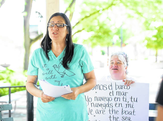 Monica Kleman speaks at the gazebo in downtown Lima during Thursday's rally in support of immigrant children.