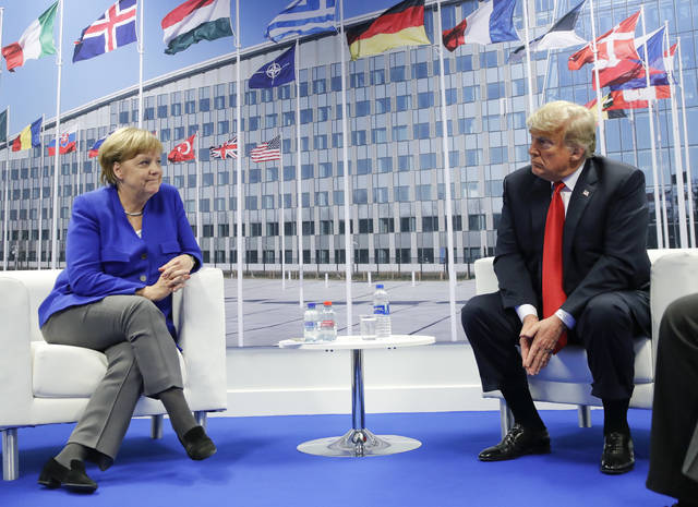 President Donald Trump and German Chancellor Angela Merkel during their bilateral meeting, Wednesday in Brussels, Belgium.