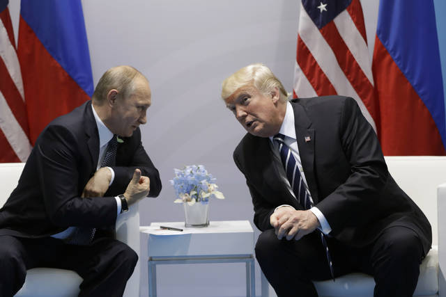"FILE - In this July 7, 2017, file photo, President Donald Trump meets with Russian President Vladimir Putin at the G20 Summit in Hamburg. Trump seems of two minds about nuclear weapons. He has mused about their elimination. But he also has called for a U.S. buildup and bragged about his nuclear ""button."" How these seemingly competing instincts will play out in his Helsinki talks with Putin on Monday could profoundly affect the direction of U.S. defense policy."