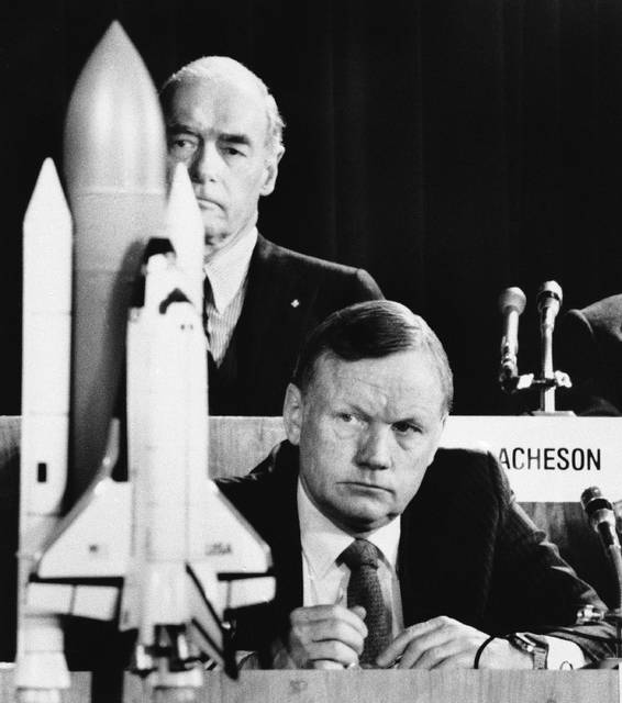 FILE - In this Feb. 11, 1986 file photo, former astronaut Neil Armstrong, a member of the presidential panel investigating the Space Shuttle Challenger explosion, listens to testimony before the commission in Washington, as David Acheson, a commission member, listens in the background. When Armstrong became the first man to walk on the moon, he captured the attention and admiration of millions of people around the world. Now fans of Armstrong and of space exploration have a chance to own artifacts and mementos that belonged to the modest man who became a global hero. The personal collection of Armstrong, who died in 2012, will be offered for sale in a series of auctions handled by Dallas-based Heritage Auctions. (AP Photo/Scott Stewart, File)
