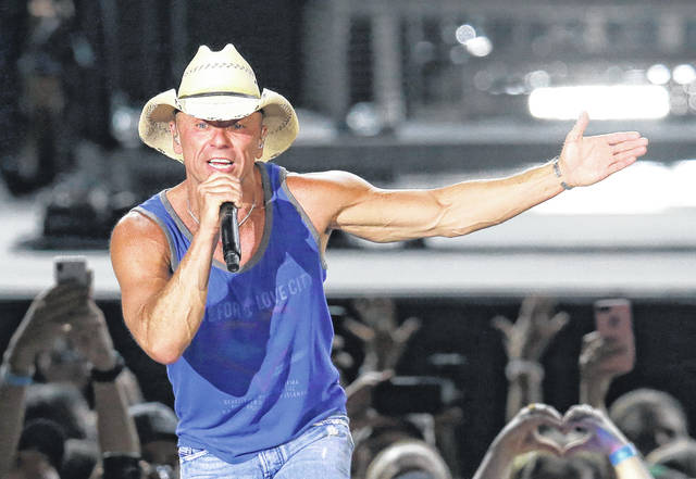 "Kenny Chesney performs during the Trip Around the Sun Tour in Phoenix on June 23. After Hurricane Irma decimated the U.S. Virgin Islands last year, Chesney started writing songs and organizing relief efforts. Chesney is donating proceeds from the sale of his new album, ""Songs for the Saints,"" to a foundation he set up to support recovery on the islands."