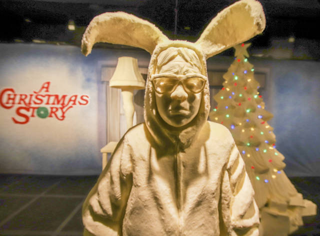 "This Monday, July 16, 2018, photo provided by the American Dairy Association Mideast shows Ohio State Fair butter sculpture depicting the character Ralphie in bunny suit pajamas from ""A Christmas Story"" in the Dairy Products Building at The Ohio Expo Center & State Fair in Columbus, Ohio. This and other sculptures mark the 35th anniversary of the 1983 movie. The American Dairy Association Mideast says sculptors spent more than 400 hours creating the refrigerated display unveiled Tuesday, July 24, 2018, crafted from more than a ton of butter. (American Dairy Association Mideast via AP)"