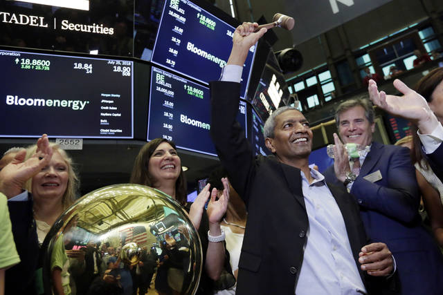 Bloom Energy Founder, President and CEO K.R. Sridhar, is applauded as he raises the gavel after ringing a ceremonial bell on the New York Stock Exchange floor, when his company's IPO begins trading, Wednesday, July 25, 2018. (AP Photo/Richard Drew)