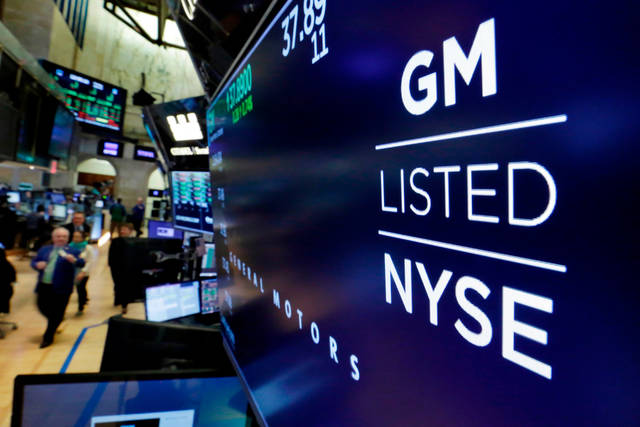 FILE - In this April 23, 2018, file photo, the logo for General Motors appears above a trading post on the floor of the New York Stock Exchange. General Motors, facing rising commodity costs in a trade showdown with Europe and elsewhere, cut its outlook for the year. Shares tumbled more than 5 percent before the opening bell, and GM's view of the year ahead dragged down shares of the entire auto sector Wednesday, July 25. (AP Photo/Richard Drew, File)