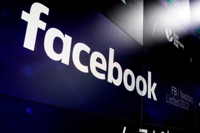 FILE - In this March 29, 2018, file photo, the logo for Facebook appears on screens at the Nasdaq MarketSite in New York's Times Square. Facebook's user base and revenue grew more slowly than expected in the second quarter of 2018 as the company grappled with privacy issues, sending its stock tumbling after hours. (AP Photo/Richard Drew, File)