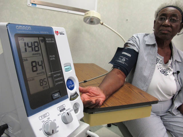 "Margaret Graham, 74, has her blood pressure checked while visiting the Wake Forest Baptist Medical Center in Winston-Salem, N.C., on Friday, July 13. She had participated in a multi-year study, published on Wednesday investigating a connection between high blood pressure and the risk of mental decline. ""I feel like maybe with this study, some findings may come that will develop new drugs and also new activities, exercise, theories that will help people to maintain an acceptable blood pressure level,"" Graham says."