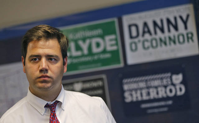 FILE – In this Thursday, July 19, 2018, file photo, Danny O'Connor, a Democrat serving as recorder of Franklin County, Ohio, listens as Boston Mayor Marty Walsh speaks to O'Connor's campaign supporters at the Democrat Party office in Delaware, Ohio. O'Connor and Ohio state Sen. Troy Balderson, R-Zanesville, are running in a special congressional election on Tuesday, Aug. 7, 2018, to determine who will fill out the final months of the term of former U.S. Rep. Pat Tiberi, a Republican who retired in January 2018, before both candidates face off again for the retired lawmaker's seat in the Nov. 6 general election.