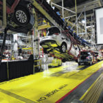 GM faces fiscal, political minefields as it assesses plants