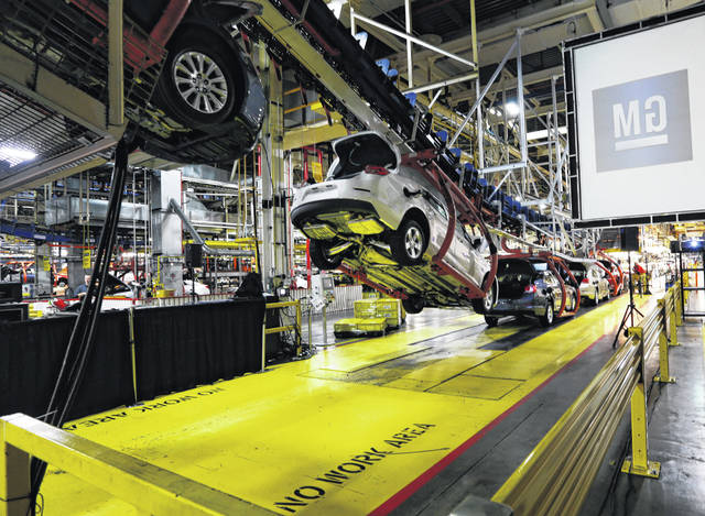 Cars move along an assembly line at the General Motors Fairfax plant in Kansas City, Kan, in January 2013. Analysts say that with too many factories making slow-selling cars, General Motors can't afford to keep them all operating without making some tough decisions.