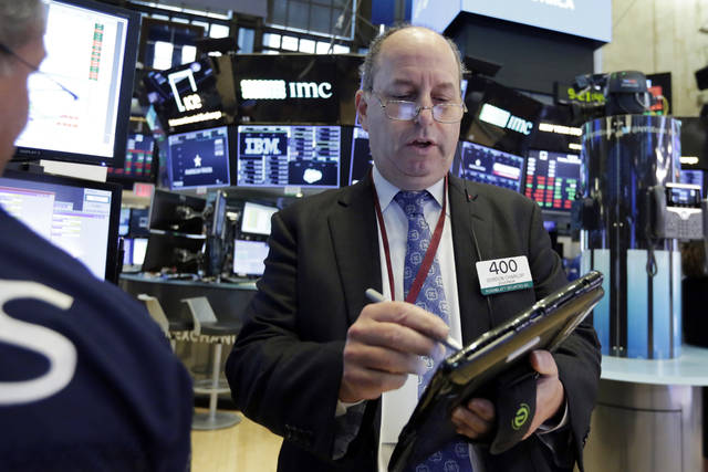 Trader Gordon Charlop works on the floor of the New York Stock Exchange, Monday, July 30, 2018. Stocks are off to a mixed start on Wall Street as gains in banks and energy companies are offset by losses in other sectors. (AP Photo/Richard Drew)