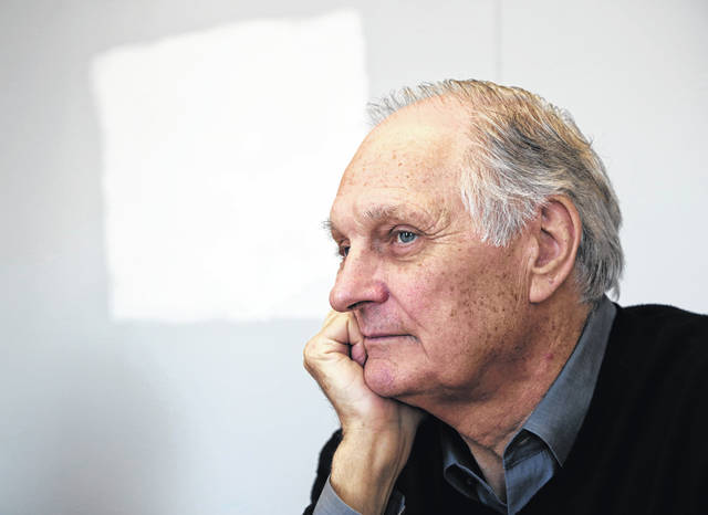 """Alan Alda listens during an interview in April 2013 at Stony Brook University, on New York's Long Island. Alda says he has Parkinson's disease. Appearing Tuesday on """"CBS This Morning,"""" the former """"M*A*S*H"""" star said he was diagnosed with the neurodegenerative disorder three and a half years ago."""