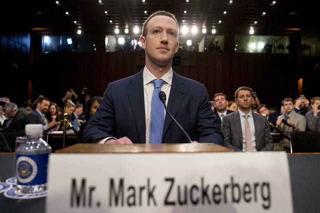 """FILE - In this April 10, 2018 file photo, Facebook CEO Mark Zuckerberg arrives to testify before a joint hearing of the Commerce and Judiciary Committees on Capitol Hill in Washington about the use of Facebook data to target American voters in the 2016 election.  Facebook said it has uncovered """"sophisticated"""" efforts, possibly linked to Russia, to influence U.S. politics on its platforms.  The company said it removed 32 accounts from Facebook and Instagram because they were involved in """"coordinated"""" political behavior and appeared to be fake.  Facebook disclosed its findings after The New York Times reported on them earlier Tuesday, July 31, 2018. (AP Photo/Andrew Harnik)"""
