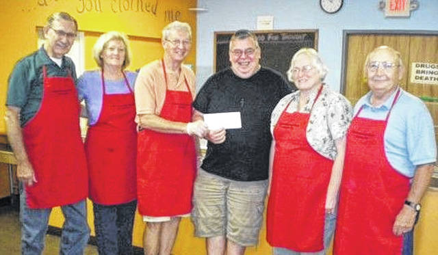 Pictured (left to right): Van Wert Presbyterian Church members: Earl Green, Leslie Wilkin, Louis Crow Soup Kitchen Director Randy Kimpel, Barb Everidge and Fred Early