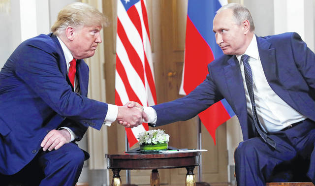 In this July 16, 2018, photo, U.S. President Donald Trump, left, and Russian President Vladimir Putin, right, shake hands at the beginning of a meeting at the Presidential Palace in Helsinki, Finland. Trump and Putin may have reached several historic agreements at their summit in Finland this week. Or, they may not have. Three days later no one is quite sure. With no details emerging from the leaders' one-on-one discussion on Monday other than the vague outline they offered themselves, officials, lawmakers and the public in the United States in particular are wondering what, if anything, was actually agreed to.