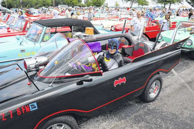 """Batman"" and ""Batgirl"" posed for pictures in Roger Salee's Batmobile at the Celina Lake Festival."