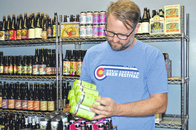 Marc Reinicke, owner of Vino Bellissimo on 2412 Cable Court, discusses the impact that the 10 percent tariff on alumium will have on beer can production.