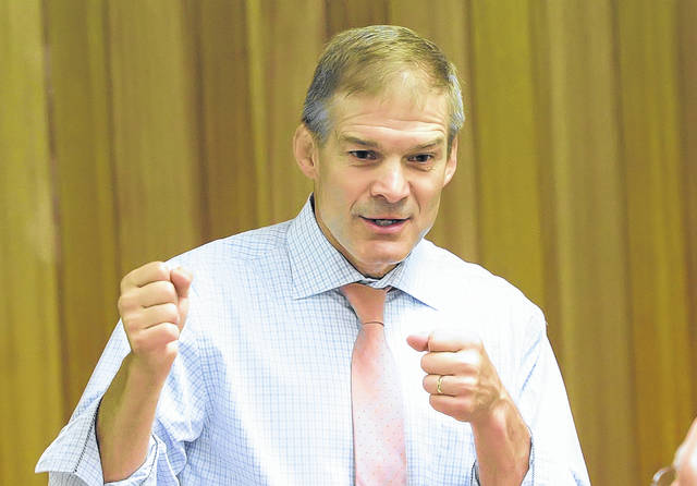Congressman Jim Jordan, R-Ohio, strikes a combative pose during a press conference Thursday in Spencerville, during which he repeated earlier statements and denied any knowledge of alleged acts of sexual misconduct surrounding the Ohio State University wrestling program while he was a coach there.