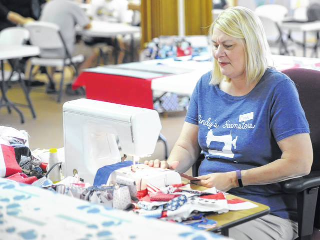 Cindy Oehlhof is a member of Spencerville United Church of Christ and the organizer of Cindy's Seamsters 102, a group of women who meet twice weekly to sew quilts for veterans who are enrolled in hospice programming offered by the Putnam County Home Health and Hospice agency.