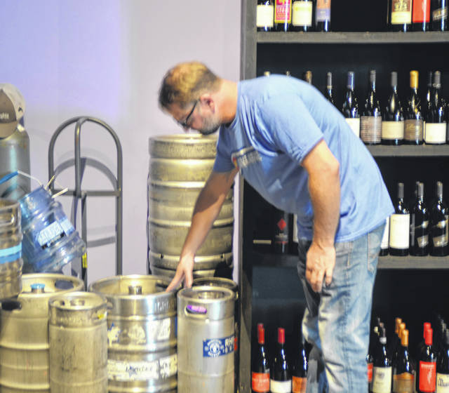 Marc Reinicke, owner of Vino Bellissimo on 2412 Cable Court, discusses the impact that the 10 percent aluminum tariff will have on keg production.