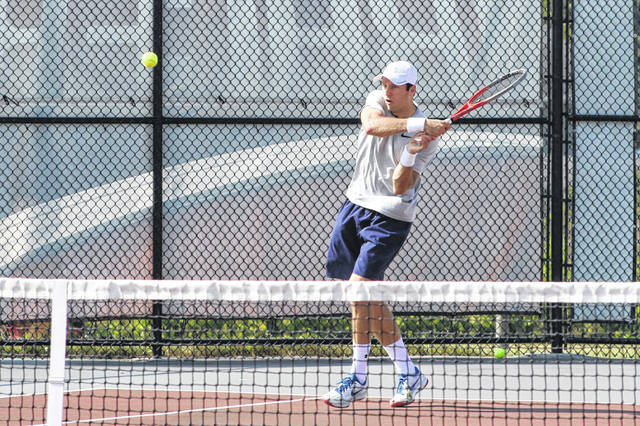 John Kidd follows through on his return while playing during the LATA mixed doubles on Sunday afternoon at UNOH. Kidd, who also won the LATA men's singles championship earlier this summer, combined with Diane French to win the mixed doubles.