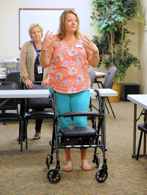 Amber Newcomer, of Greene Respiratory Services, speaks at a recent prevention workshop at Liberty Retirement Home in Lima. One program focuses on avoiding falls in the home.