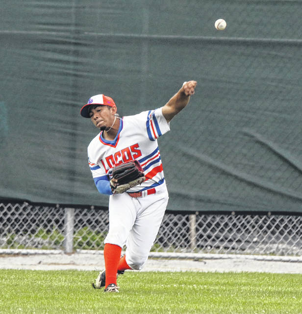 The Lima Locos' Mark Castelblanco makes a throw from the outfield during the first game of Saturday night's doubleheader against Irish Hills at Simmons Field.